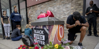 In Minneapolis, a Black Man Dies After A White Officer Press His Knee Into His Neck for Five Minutes